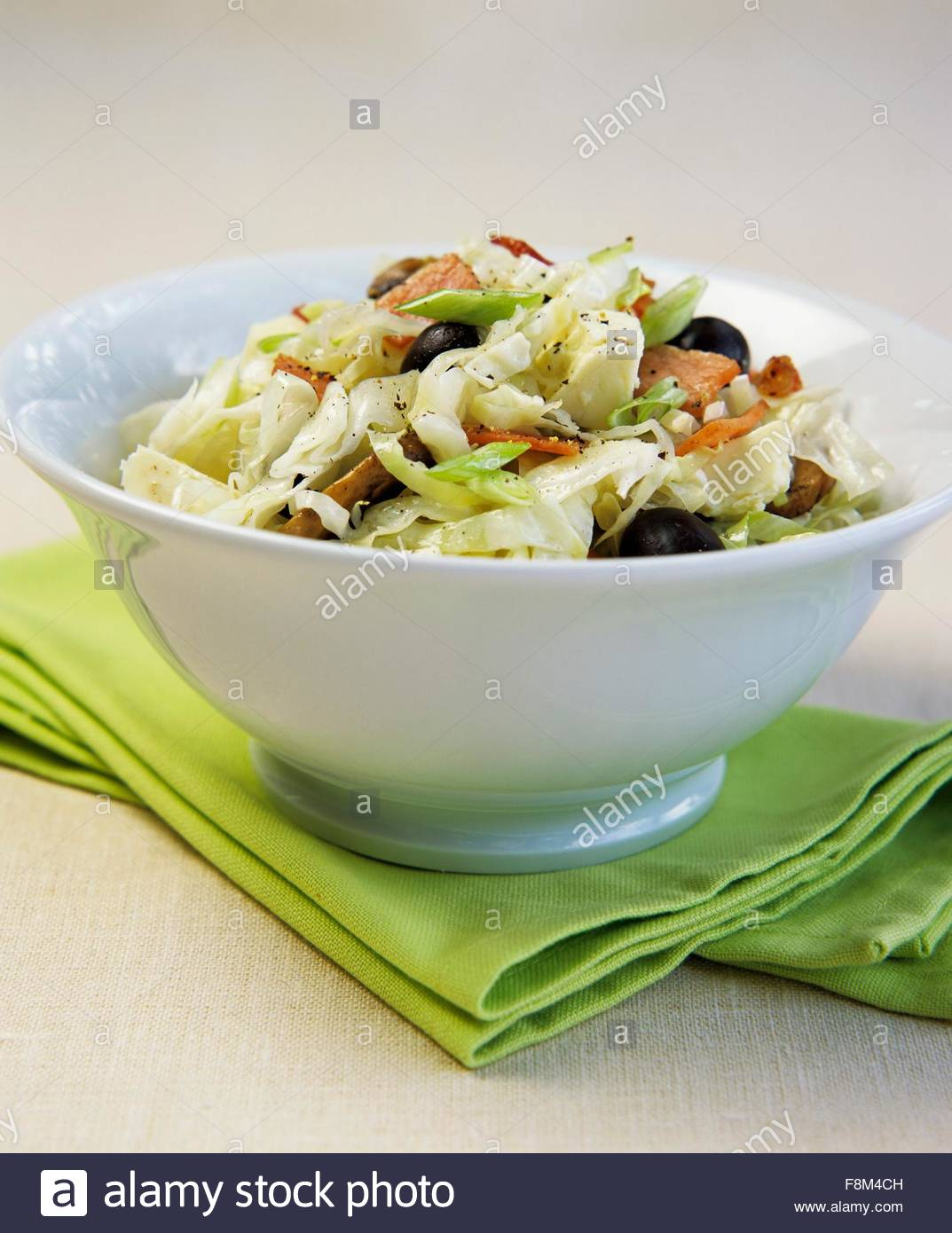 White cabbage with bacon, feta and olives - Stock Image