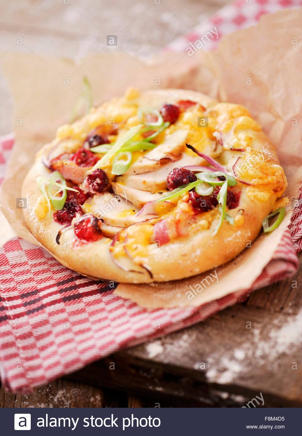 Chicken and cranberry mini-pizza - Stock Image