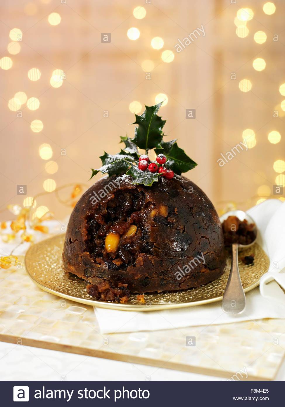 Christmas pudding with holly - Stock Image
