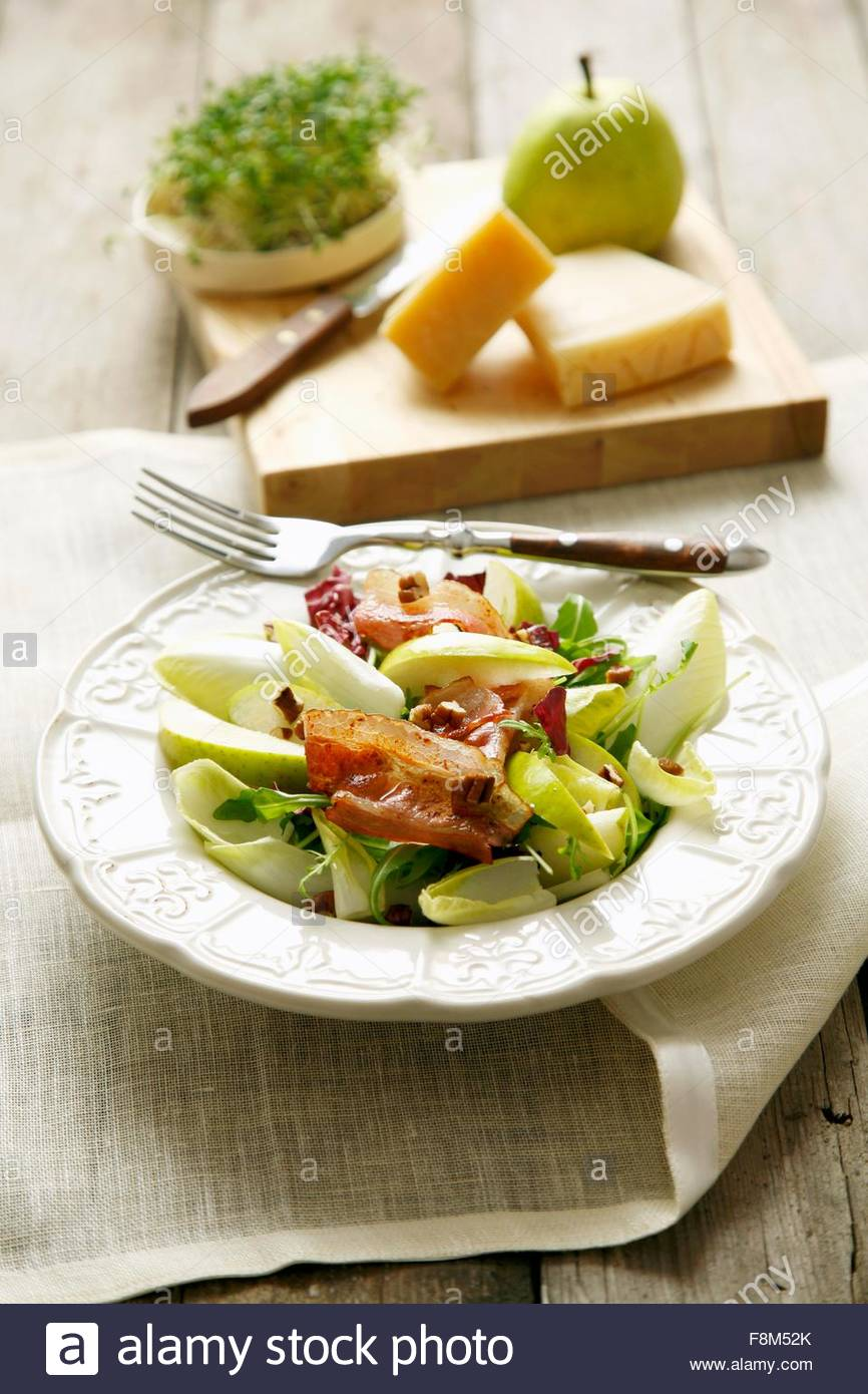 Chicory, bacon and pear salad - Stock Image
