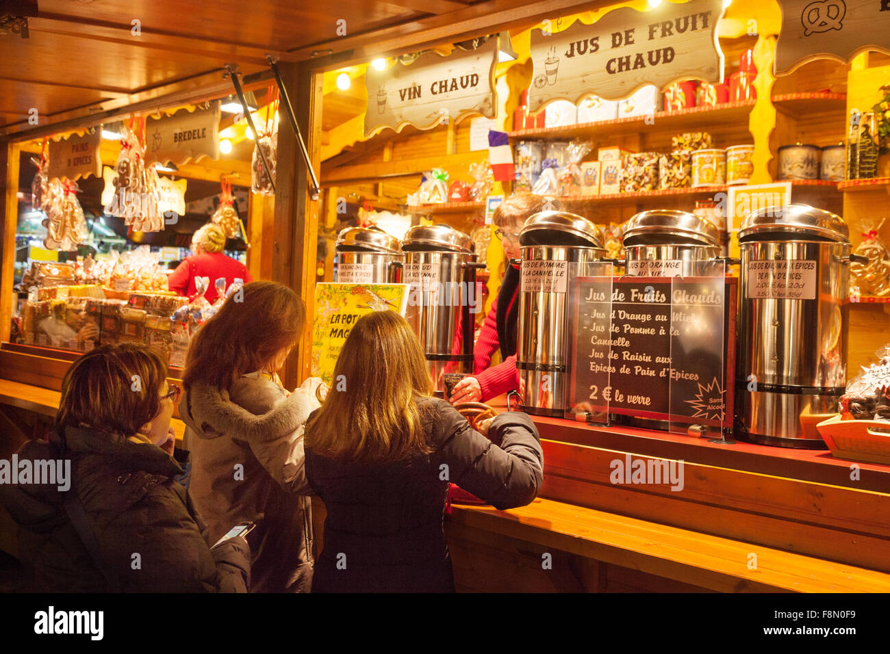 Women buying Vin Chaud ( Mulled Wine ) at a stall, Strasbourg Christmas market, Alsace, France Europe Stock Photo
