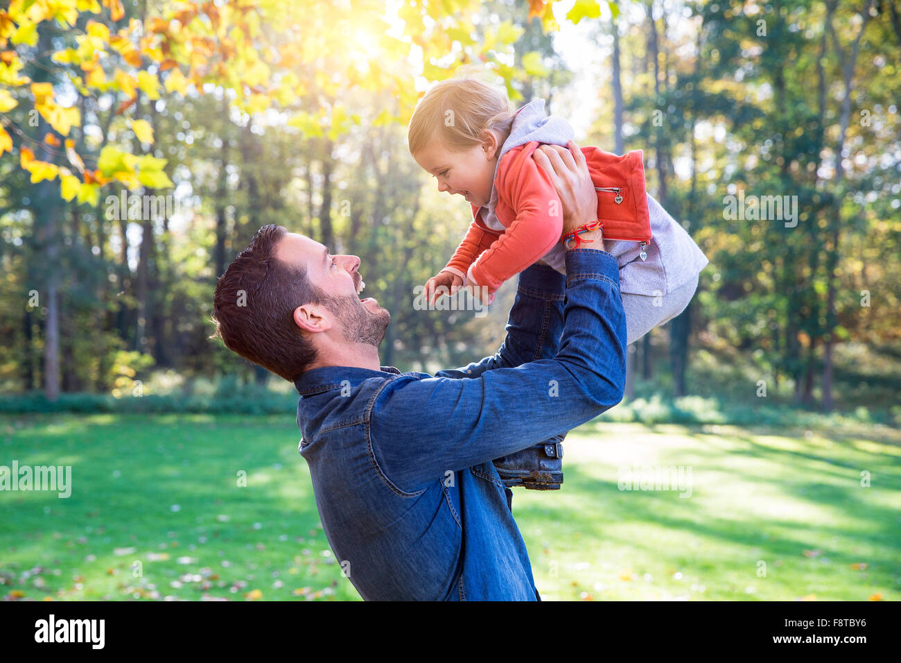 Dad playing with his daughter - Stock Image