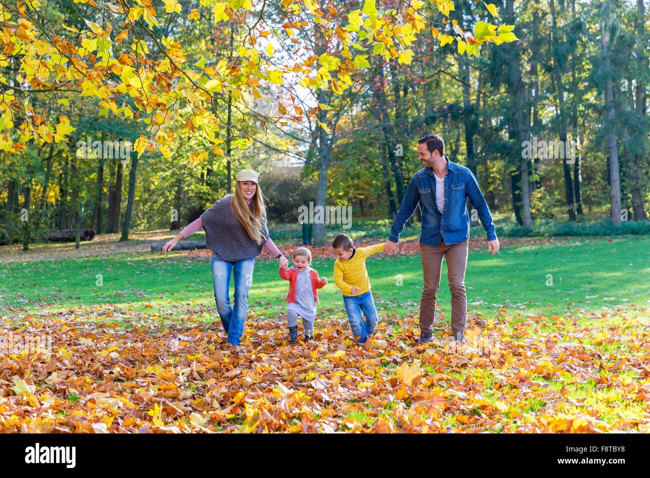 Family walking in park - Stock Image