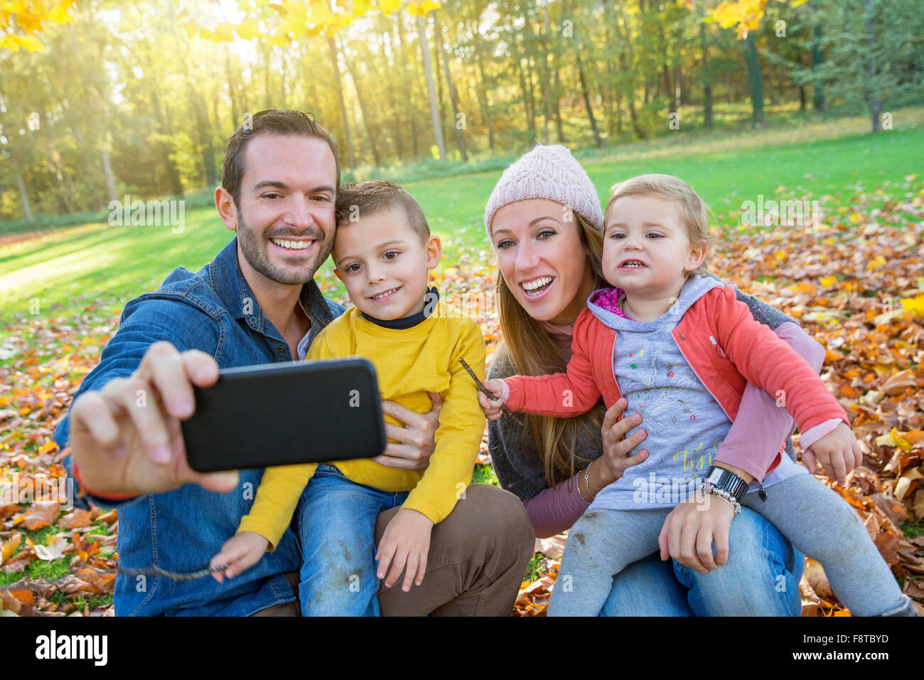 Family taking a selfie - Stock Image