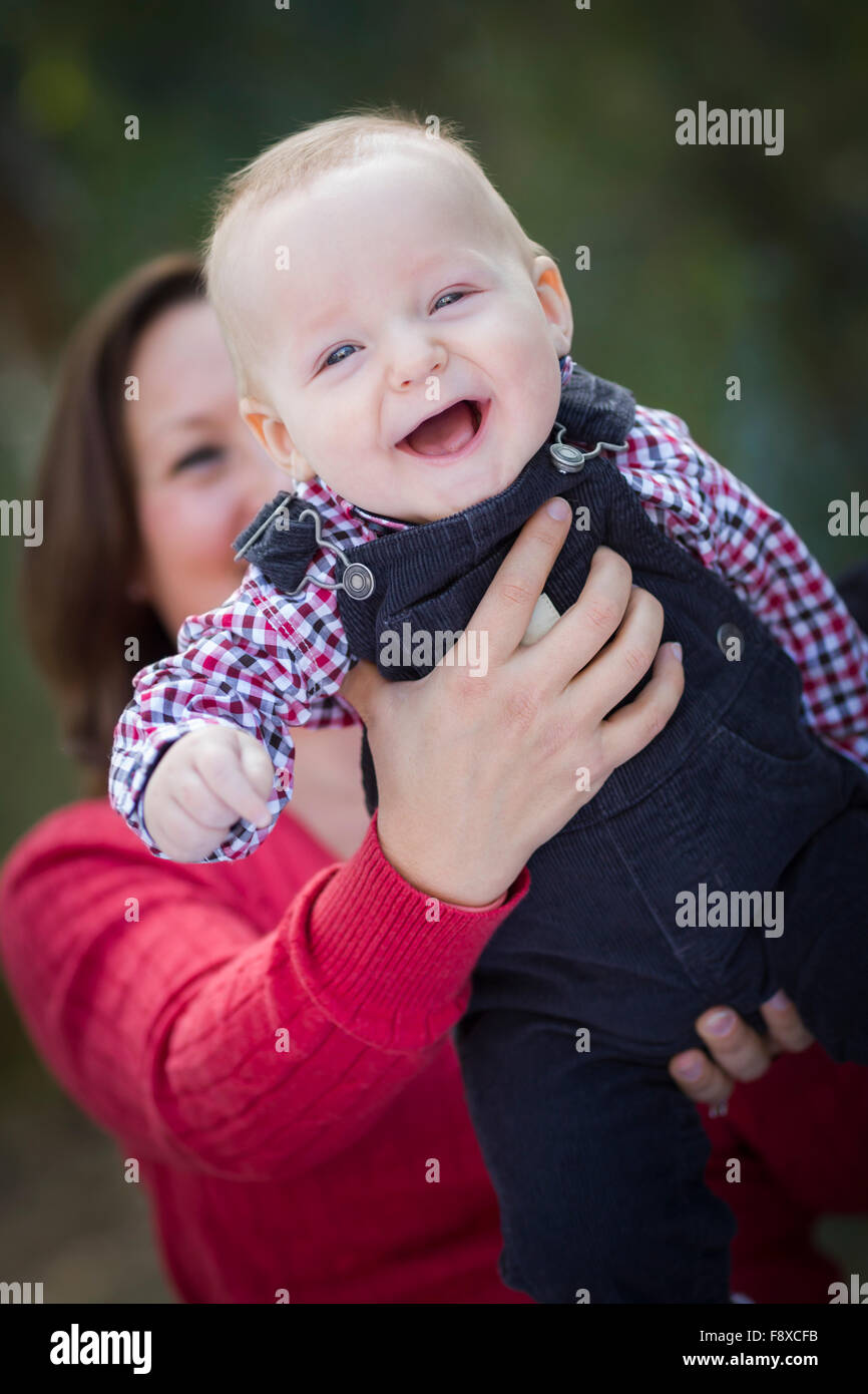 Cute Little Baby Boy Having Fun With Mommy Outdoors. - Stock Image