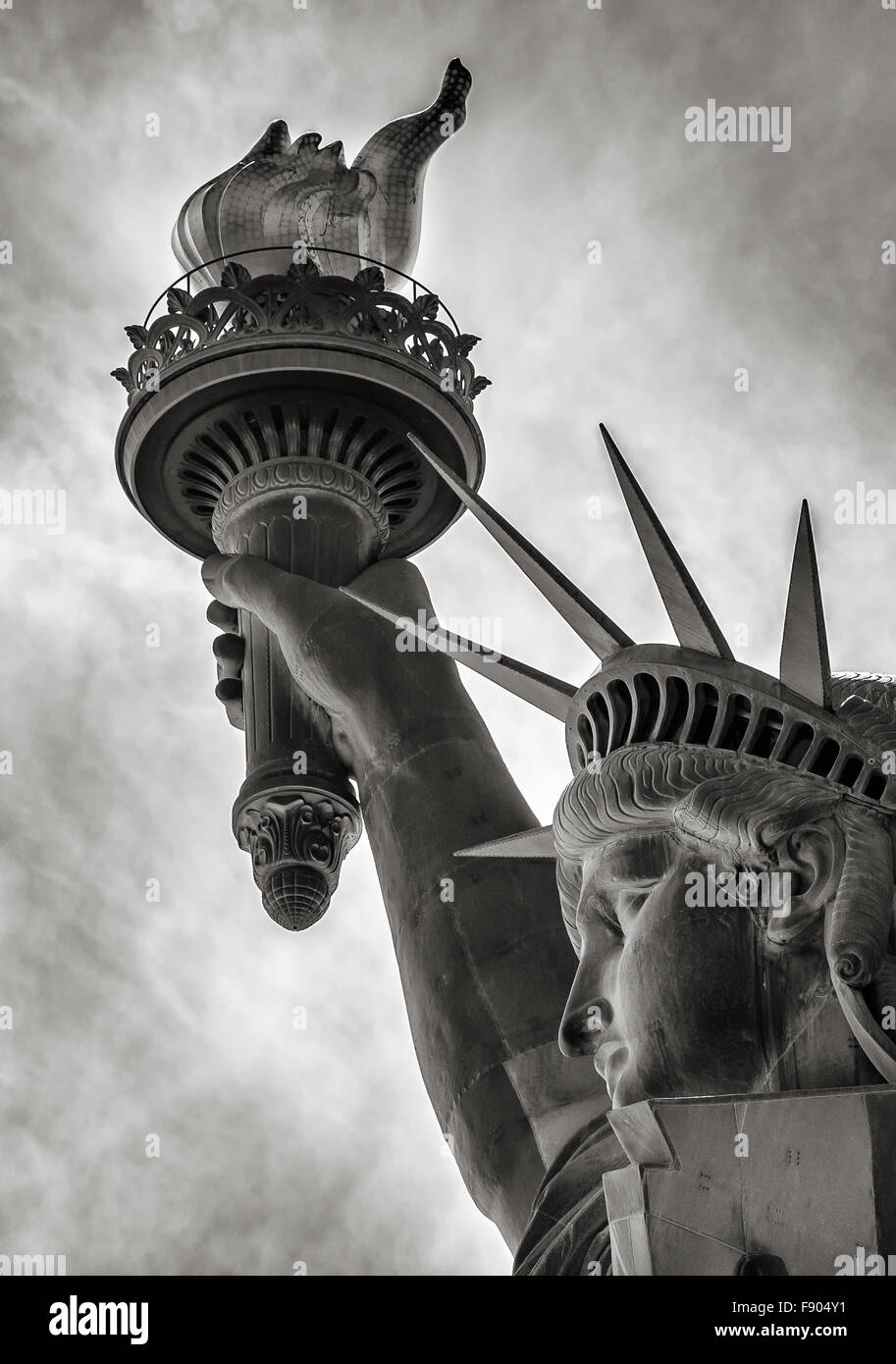 Black & White detail of torch, crown and profile of the Statue of Liberty, Liberty Island, New York City - Stock Image