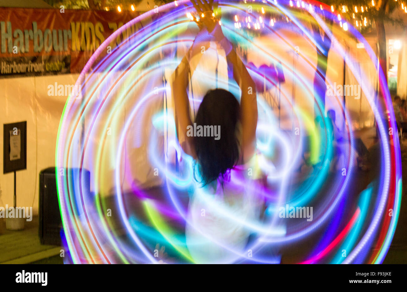 woman-spinning-rainbow-hula-hoops-at-world-pride-party-in-toronto-F93JKE.jpg
