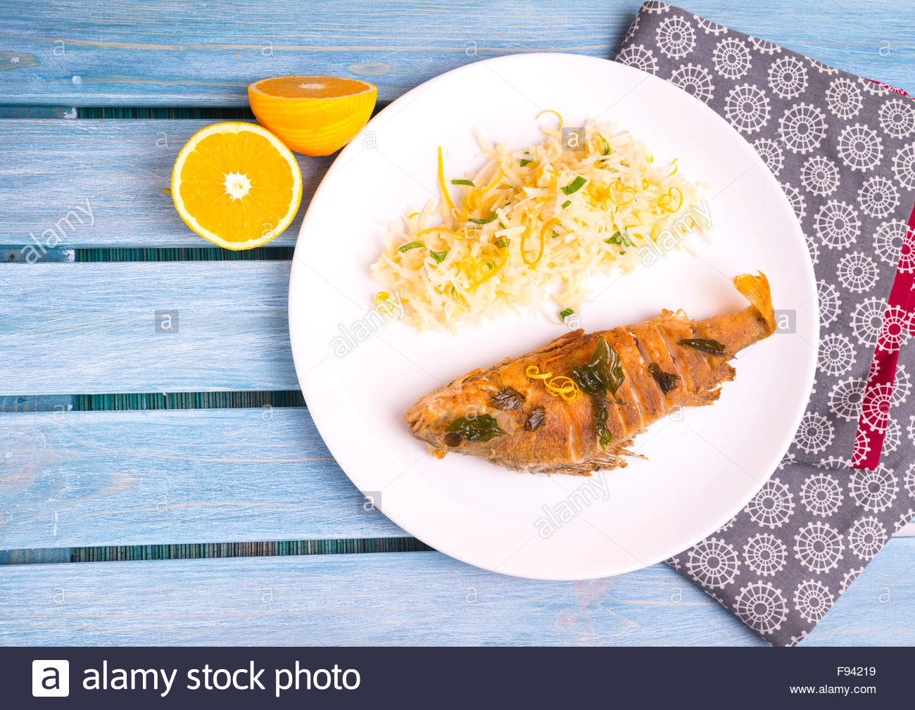 European perch fried with Thai basil and lemon, served with turnip and oranges salad - Stock Image