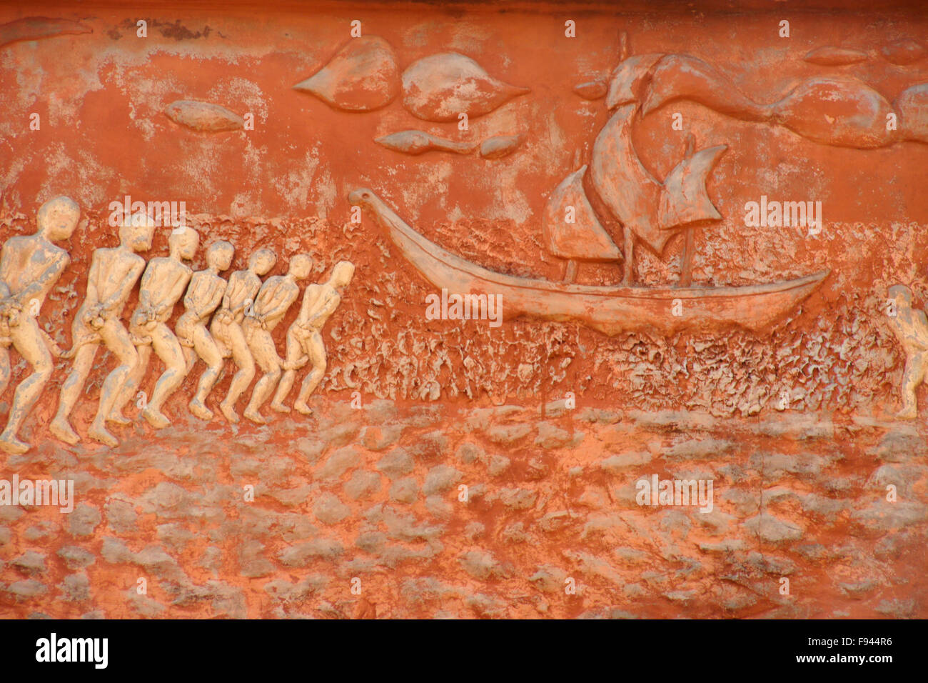 Chained slaves going to ship, mural on Door of No Return memorial, Ouidah, Benin Stock Photo