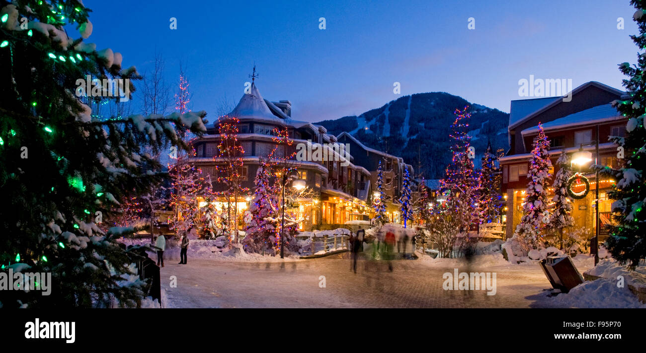 the lights of christmas sparkle in whistler village on a winter evening