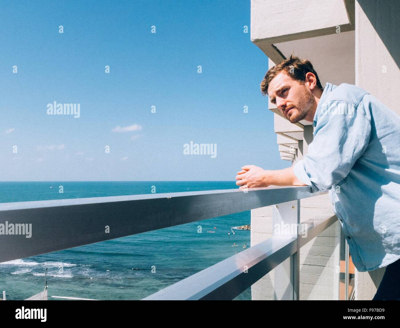 man looking away while leaning on railing stock photo 91746405 alamy