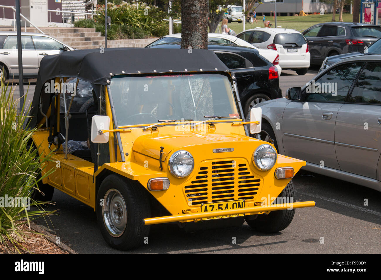 yellow Mini moke motor car parked in north sydney, australia - Stock Image