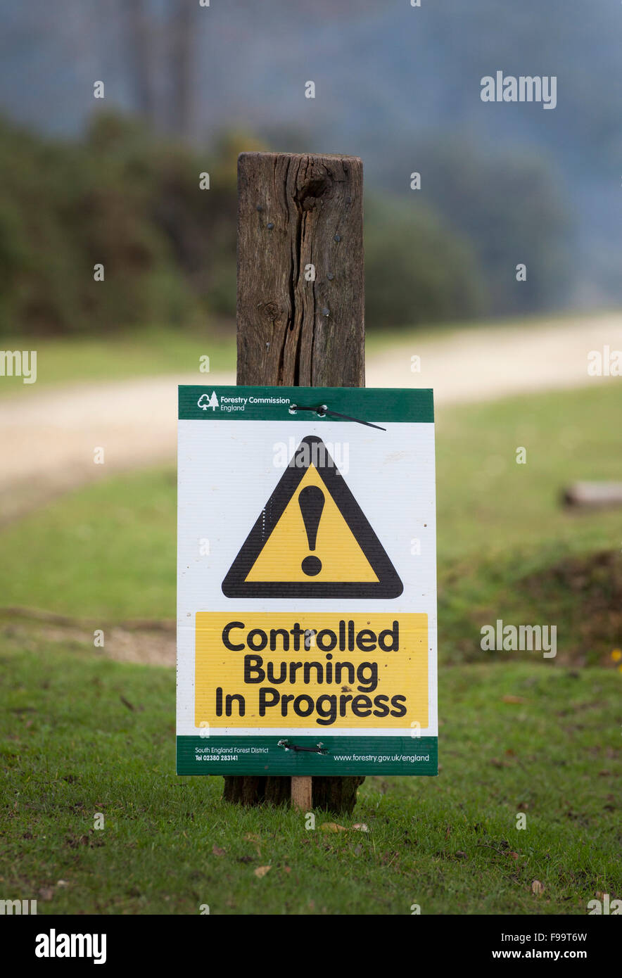 Controlled Burning in Progress sign in the New Forest Hampshire UK - Stock Image