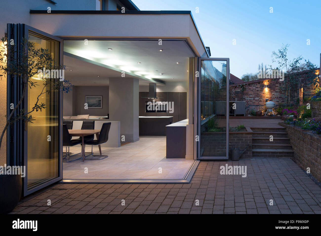 Kitchen And Dining Areas Seen Through Open Bi Fold Doors From The