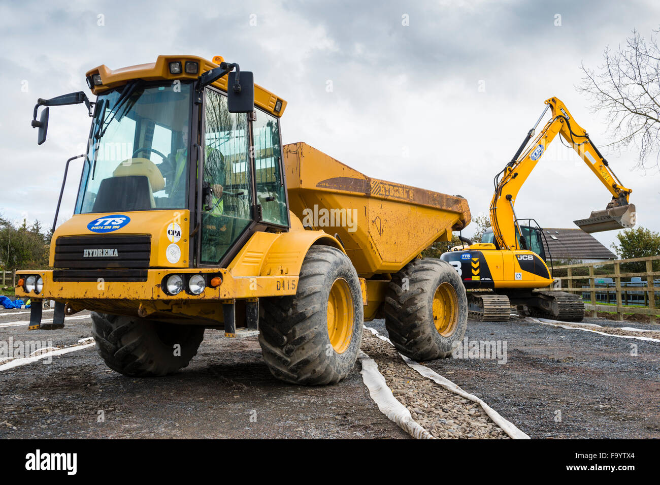 Yellow heavy dumper truck and JCB digger excavator plant ...