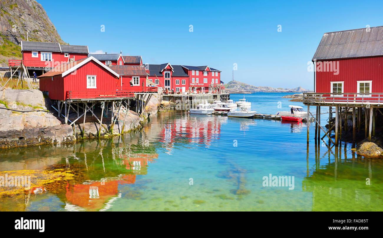 Traditional red wooden rorbu houses on Moskenesoya Island, Lofoten Islands, Norway - Stock Image