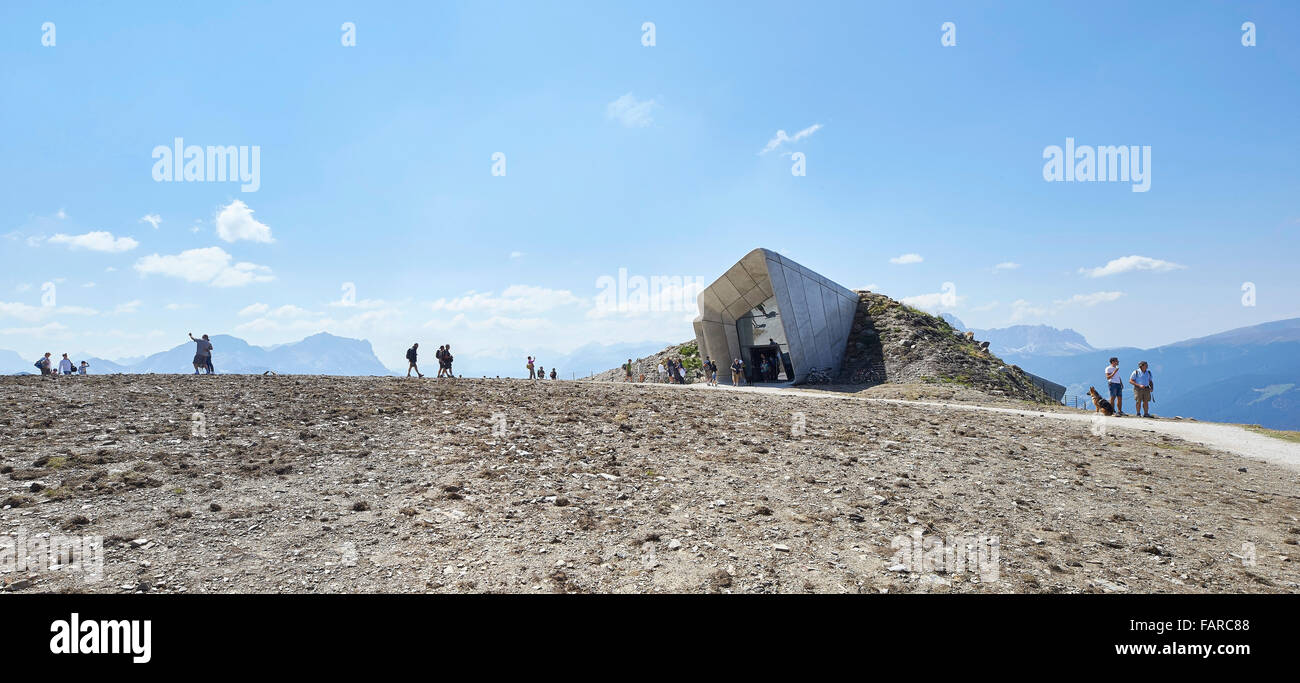 Rocky surface with entrance and visitors. Messner Mountain Museum Corones, Mount Kronplatz, Italy. Architect: Zaha - Stock Image