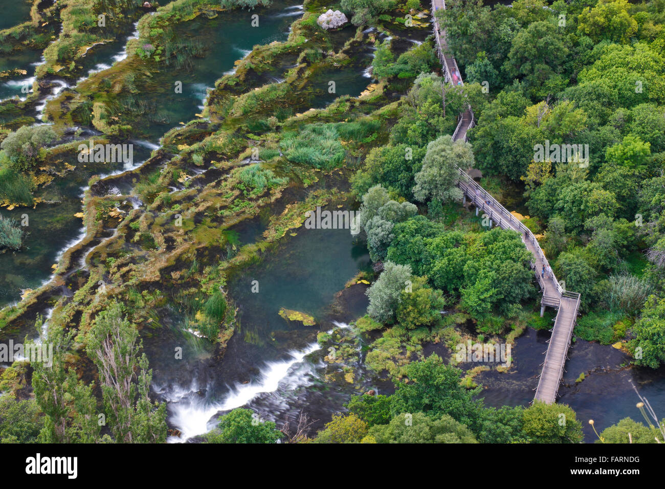 Wooden bridge over river Krka in National park Krka, Croatia - Stock Image