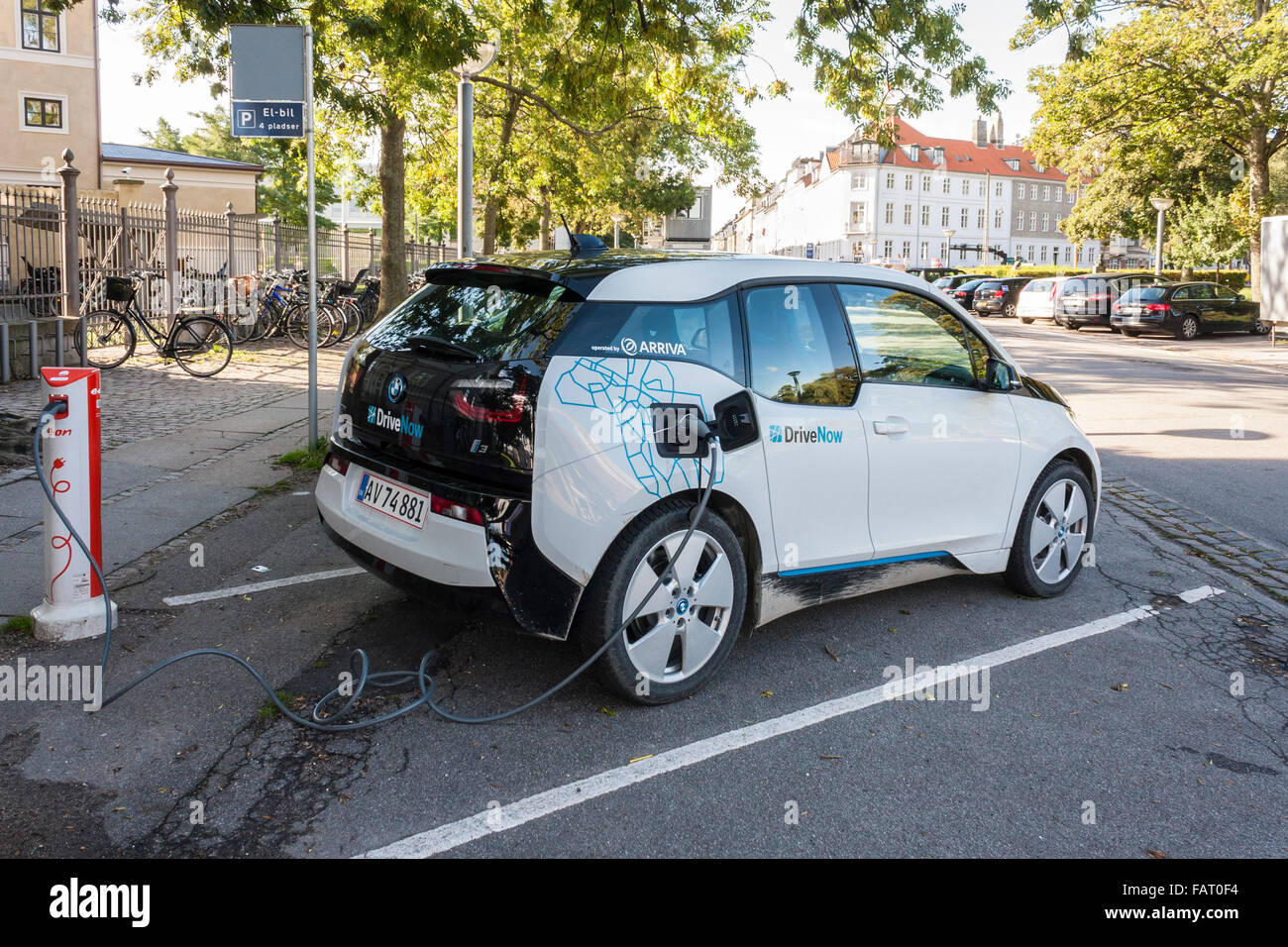BMW i3 electric car being charged on street. Copenhagen, Denmark, Europe. - Stock Image