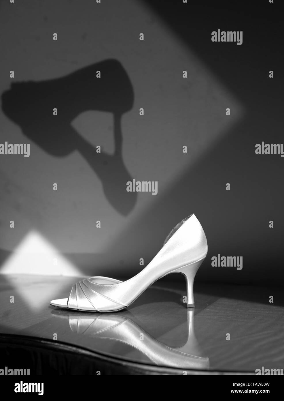 Black and white of a lonely shoe. - Stock Image