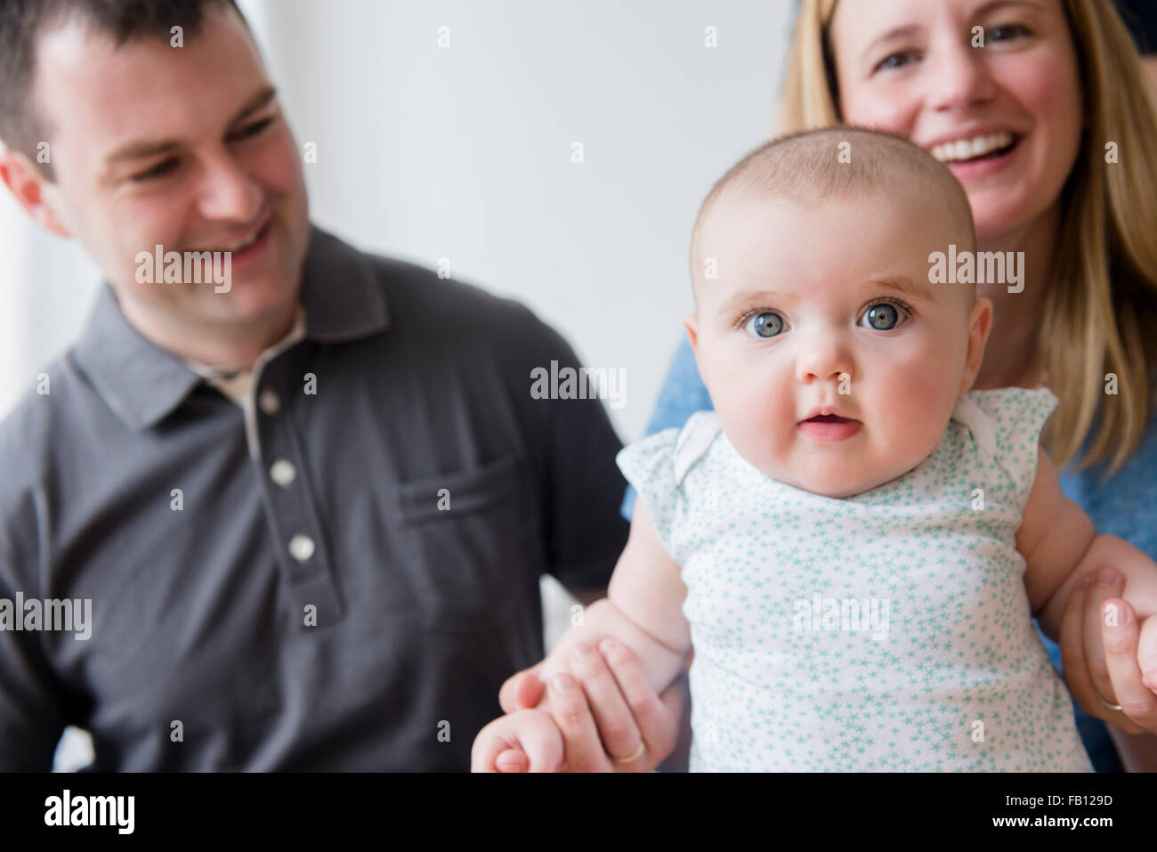 Parents with baby daughter (12-17 months) Stock Photo