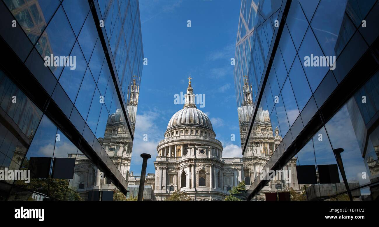 View of St Pauls Cathedral between glass fronted office buildings, London, UK - Stock Image