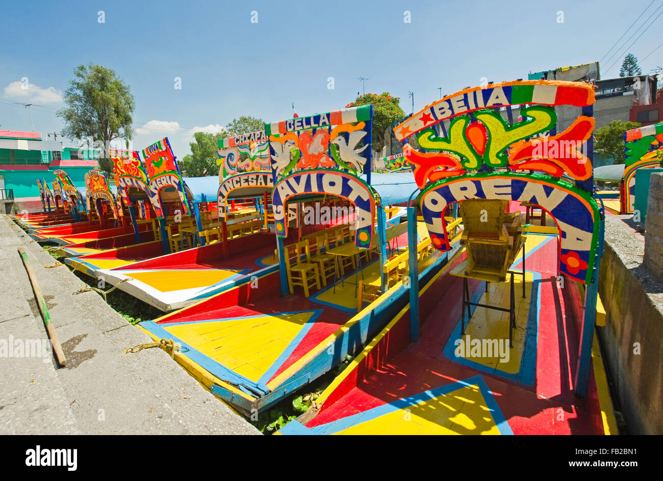 The colourful tourist boats on the canals of Xochimilco in Mexico City, Mexico, South America - Stock Image