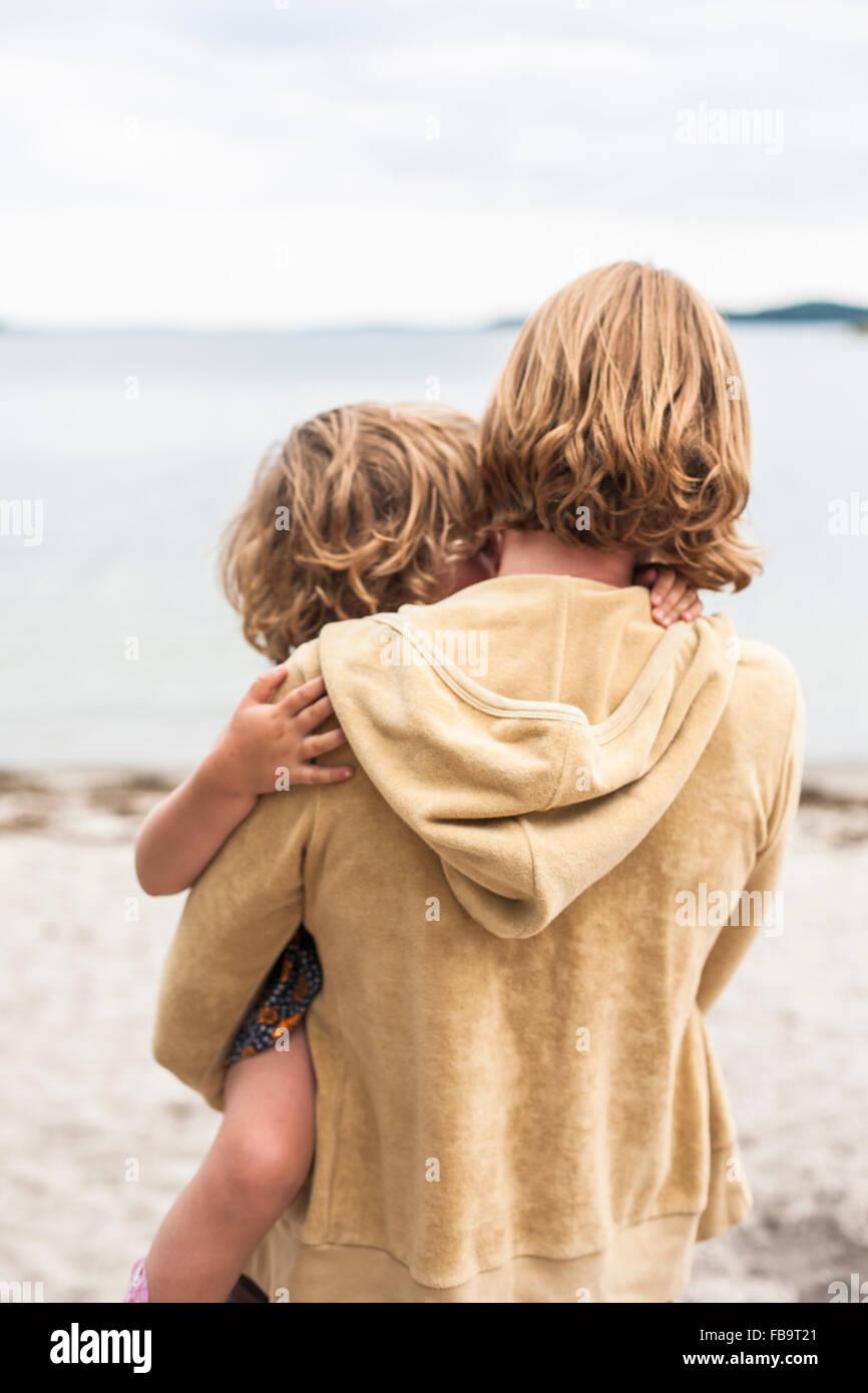 Sweden, Sodermanland, Stockholm Archipelago, Musko, Mother holding daughter (4-5) - Stock Image