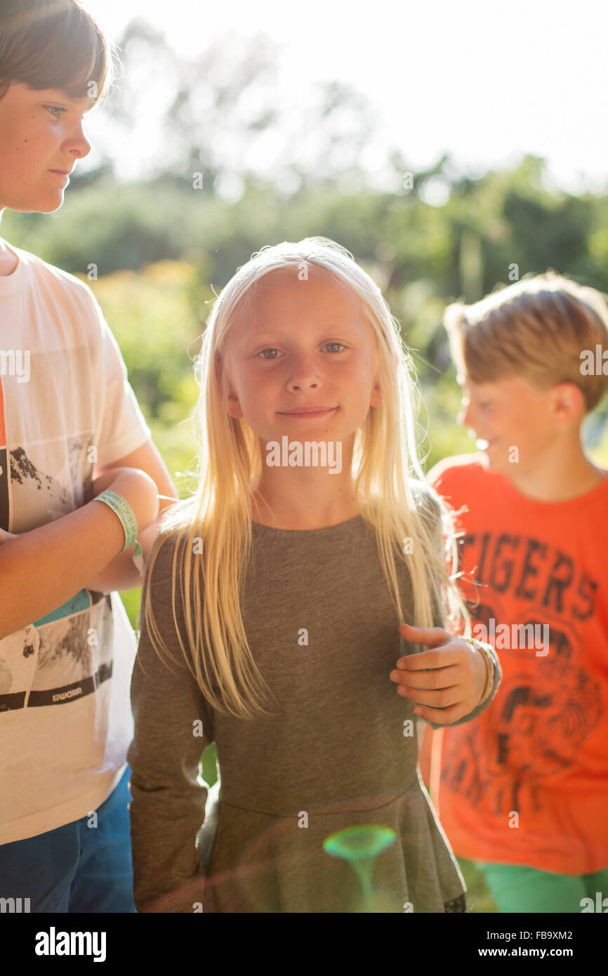 Sweden, Skane, Osterlen, Boy (12-13) standing next to sister ( 10-11) - Stock Image