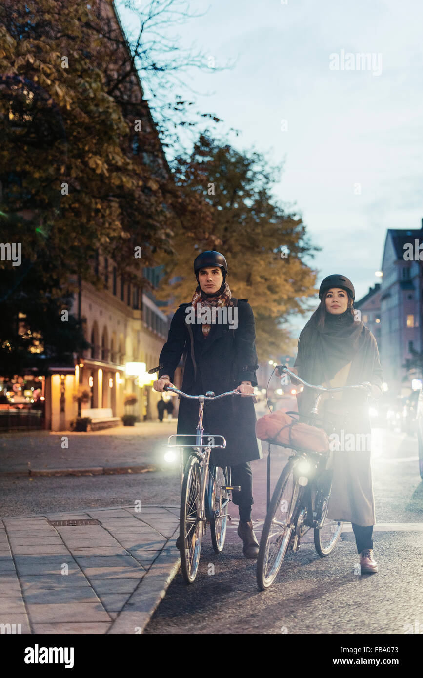 Sweden, Uppland, Stockholm, Vasatan, Sankt Eriksgatan, Man and woman cycling on city street - Stock Image