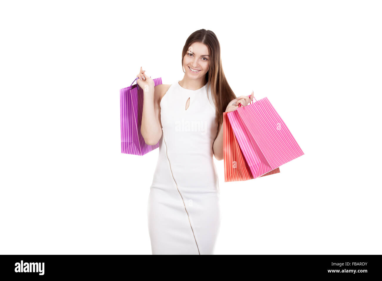 Smiling female holding colored shopping bags, copy space, isolated on white background. Concepts: sales, rest, stress - Stock Image