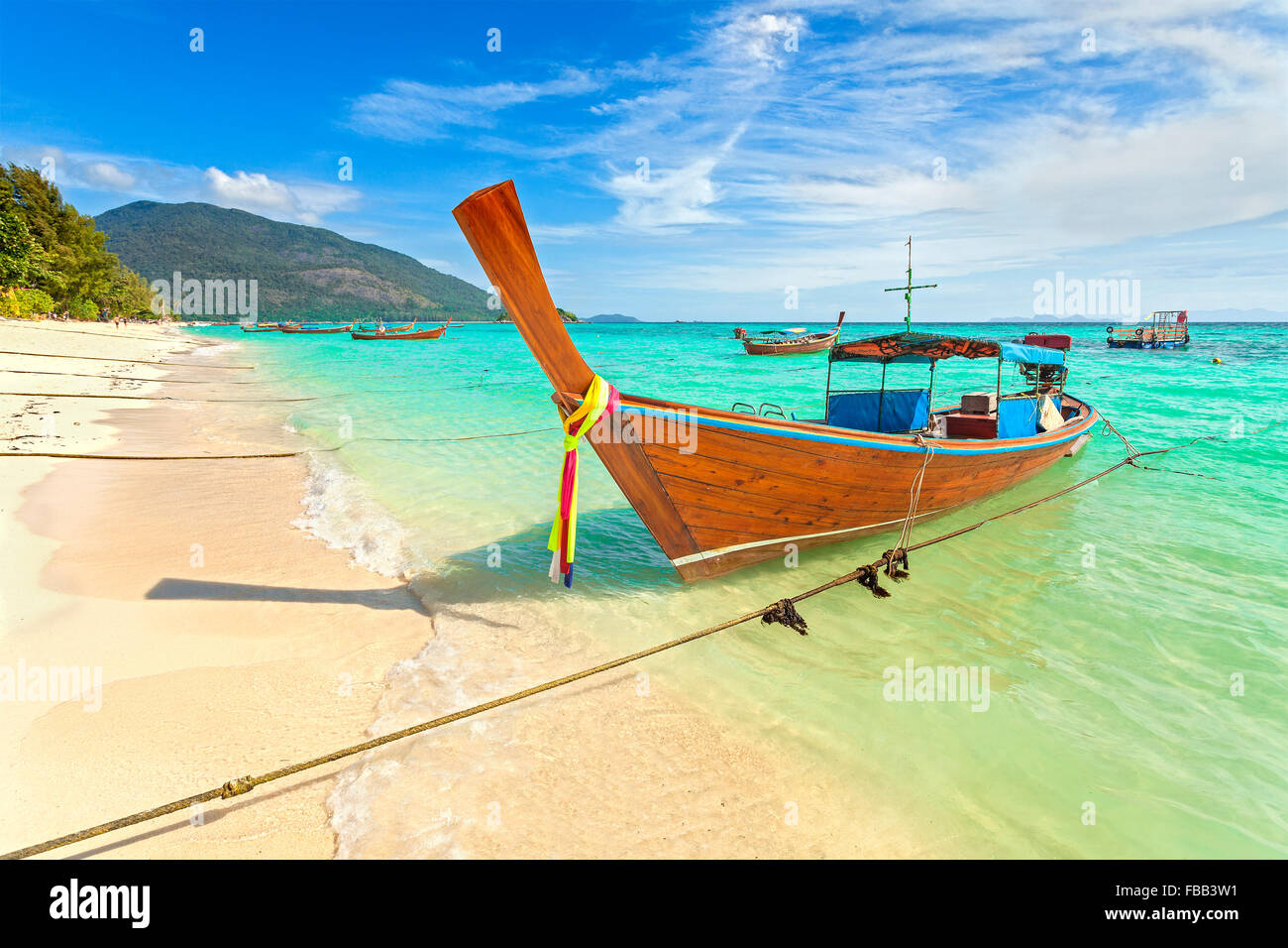 Long tail boat at a beautiful beach, Thailand. - Stock Image