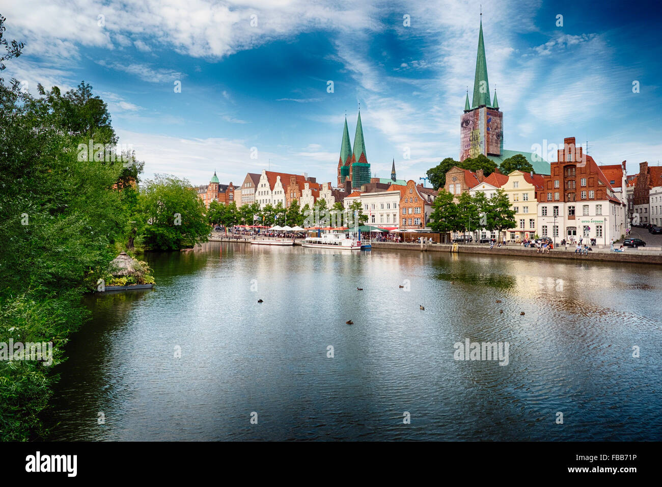 View of the Waterfront of Old Town Lubeck with the Trave Canal, Schleswig-Holstein, Germany Stock Photo