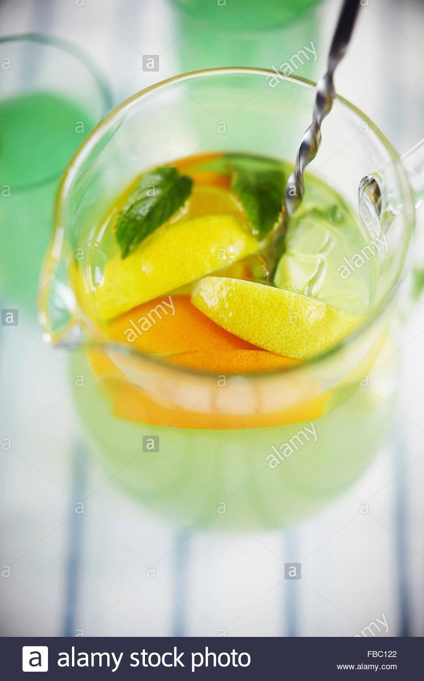 Jugful of orange and lemon lemonade - Stock Image
