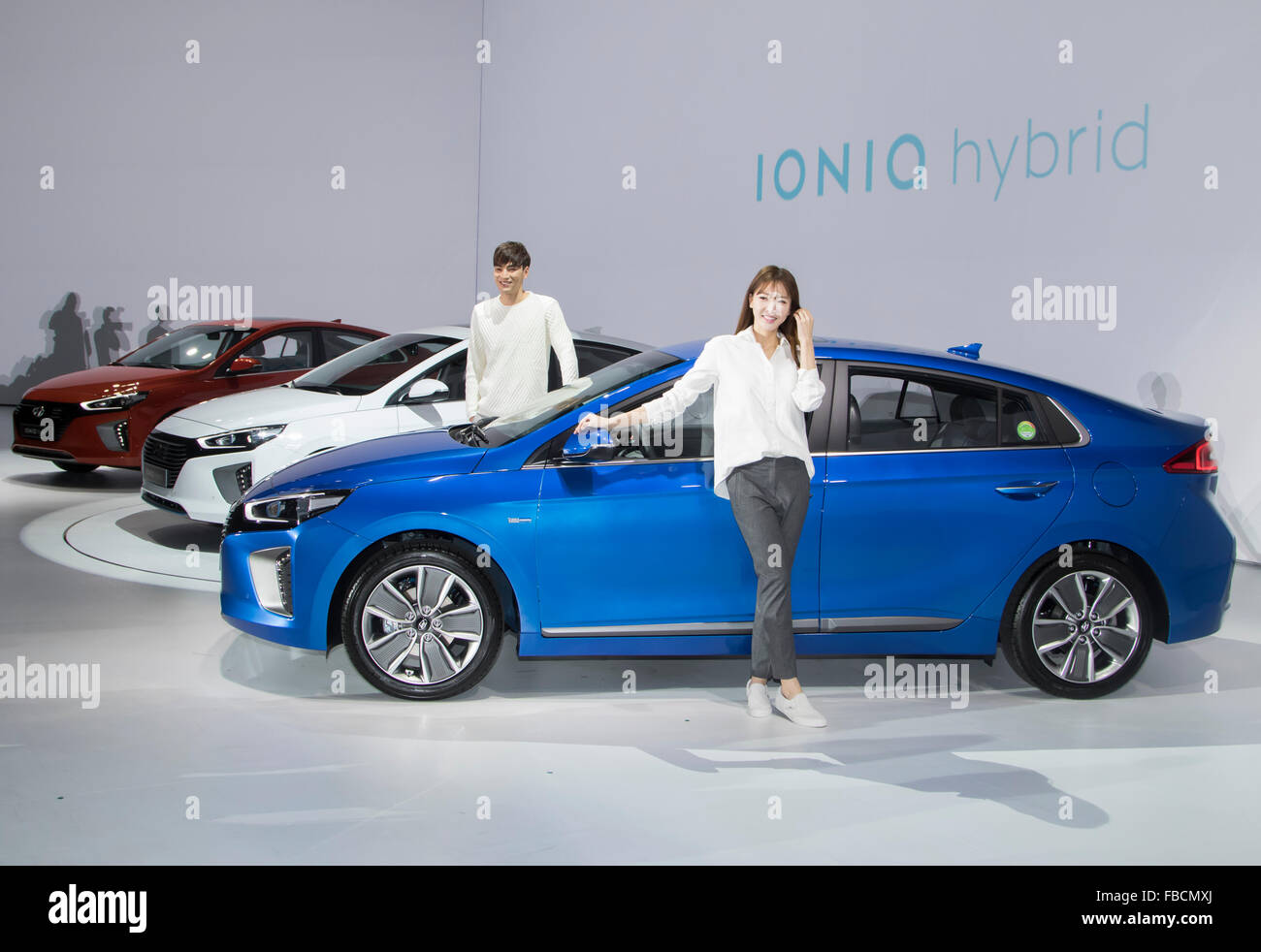 Ioniq Hybrid, Jan 14, 2016 : Models pose next to Hyundai Motor's Ioniq hybrid cars during a press conference - Stock Image