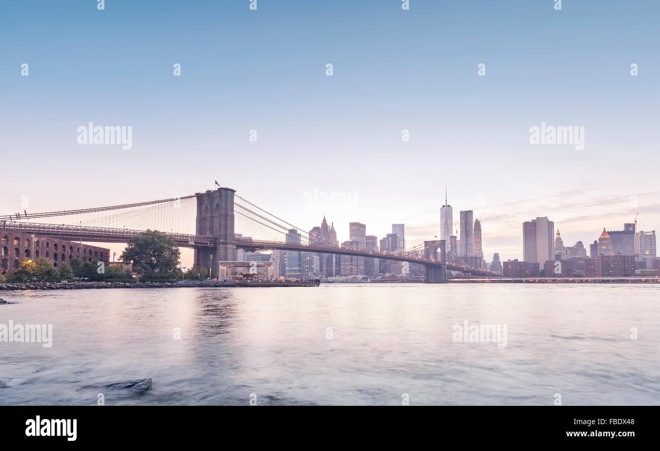 Brooklyn Bridge and Manhattan in rose quartz and serenity colors, New York, USA. - Stock Image