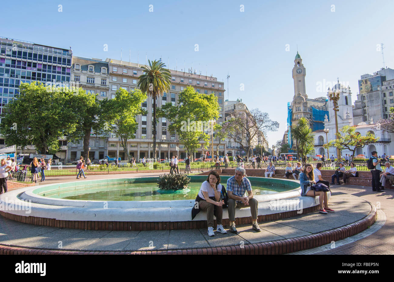 Buenos Aires Argentina Plaza de Mayo people sitting on fountain in main square of city center - Stock Image