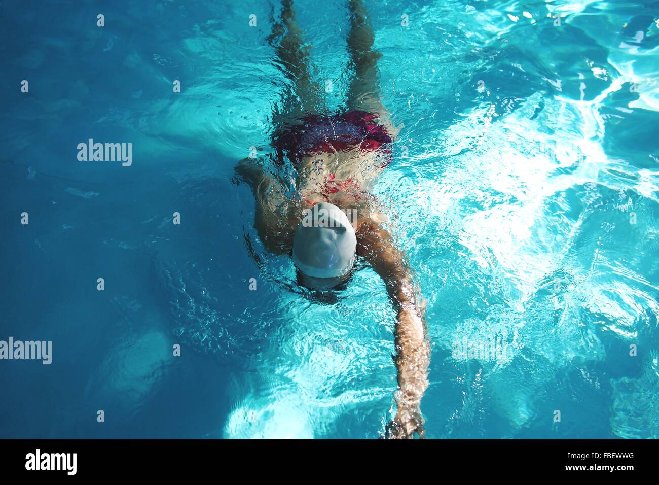 High Angle View Of Woman In Swimming Pool - Stock Image