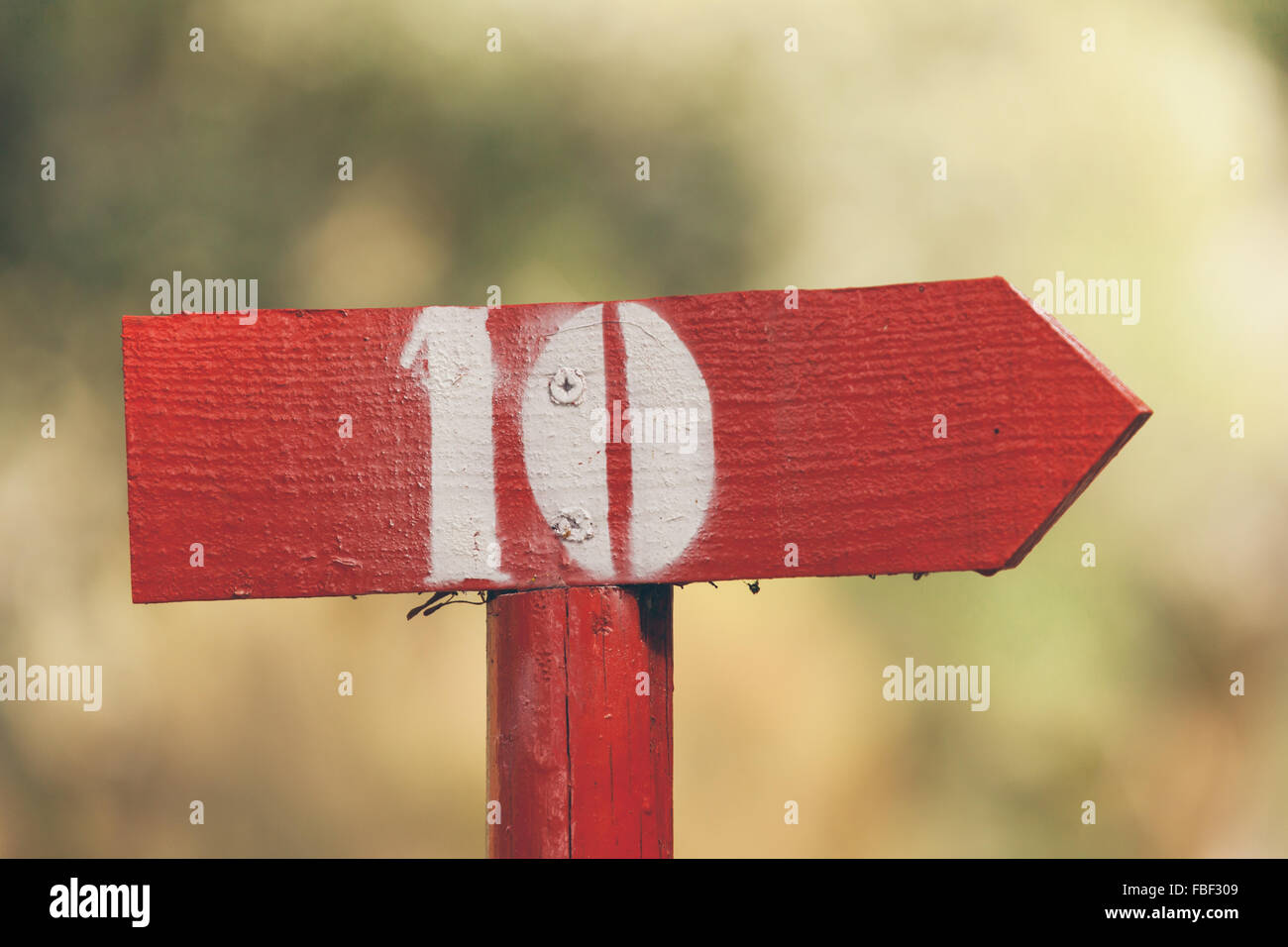Close-Up Of Directional Sign With Number 10 - Stock Image