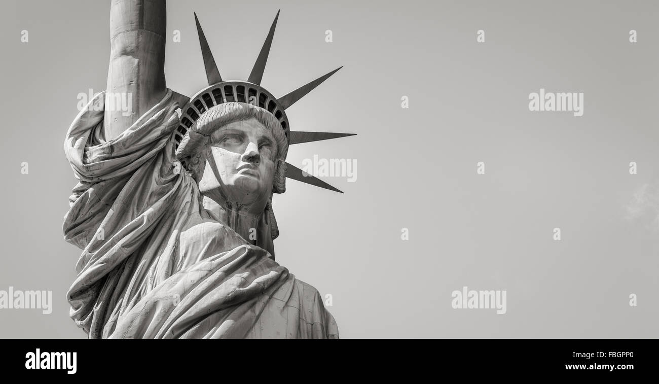 Panoramic close-up of the Statue of Liberty in Black & White including head, crown and arm. Liberty Island, - Stock Image