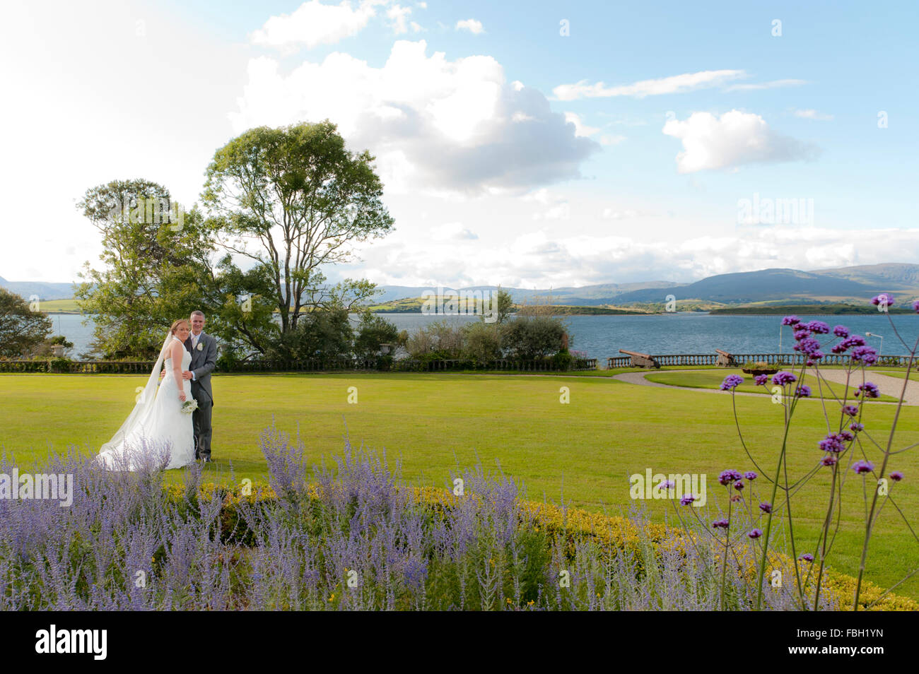 a-bride-and-groom-are-pictured-in-the-grounds-of-bantry-house-and-FBH1YN.jpg