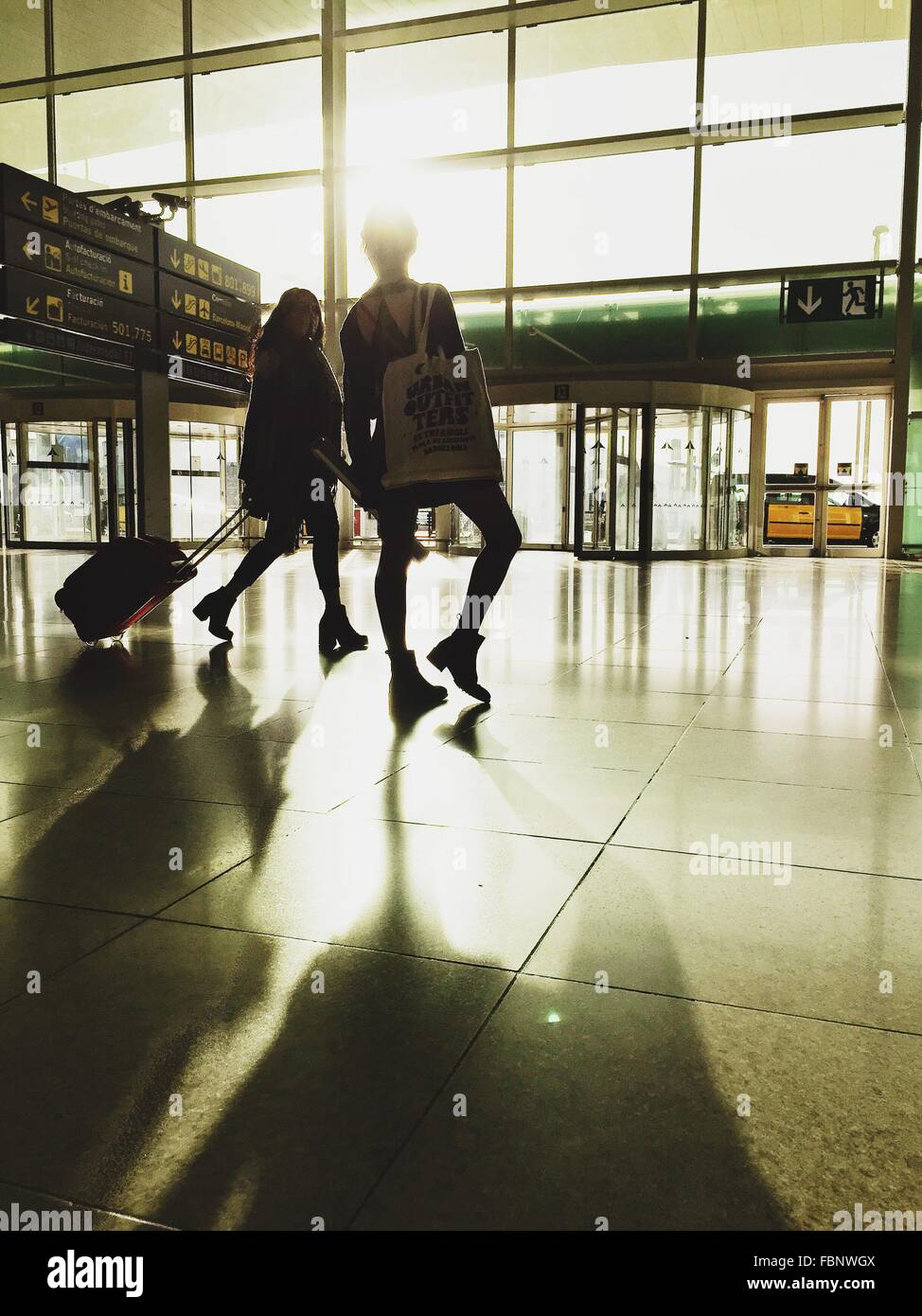 Shadow Of Women On Floor At Airport - Stock Image