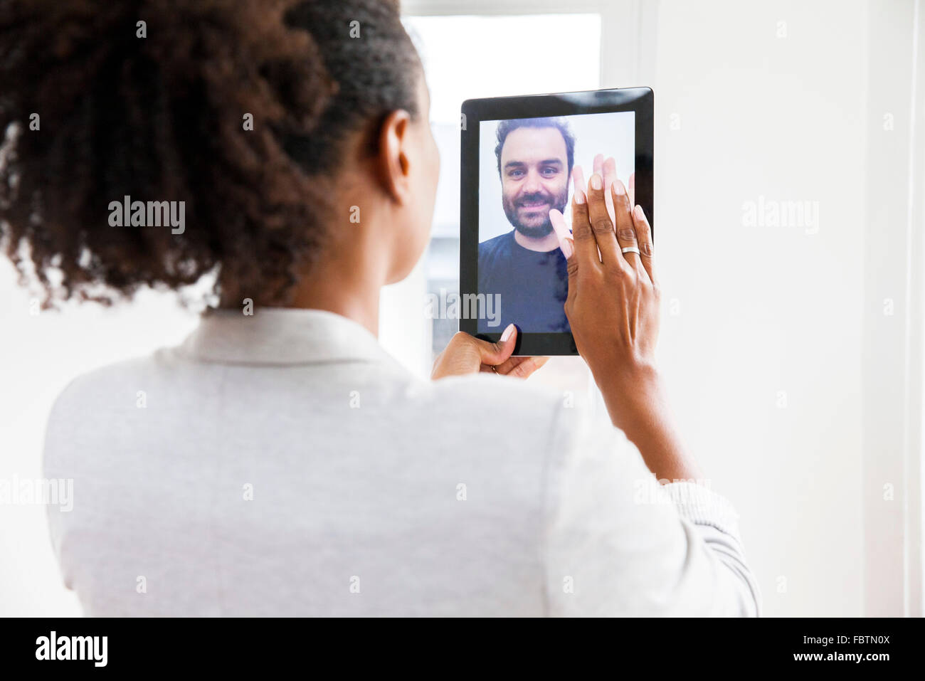 Couple doing video chat - Stock Image