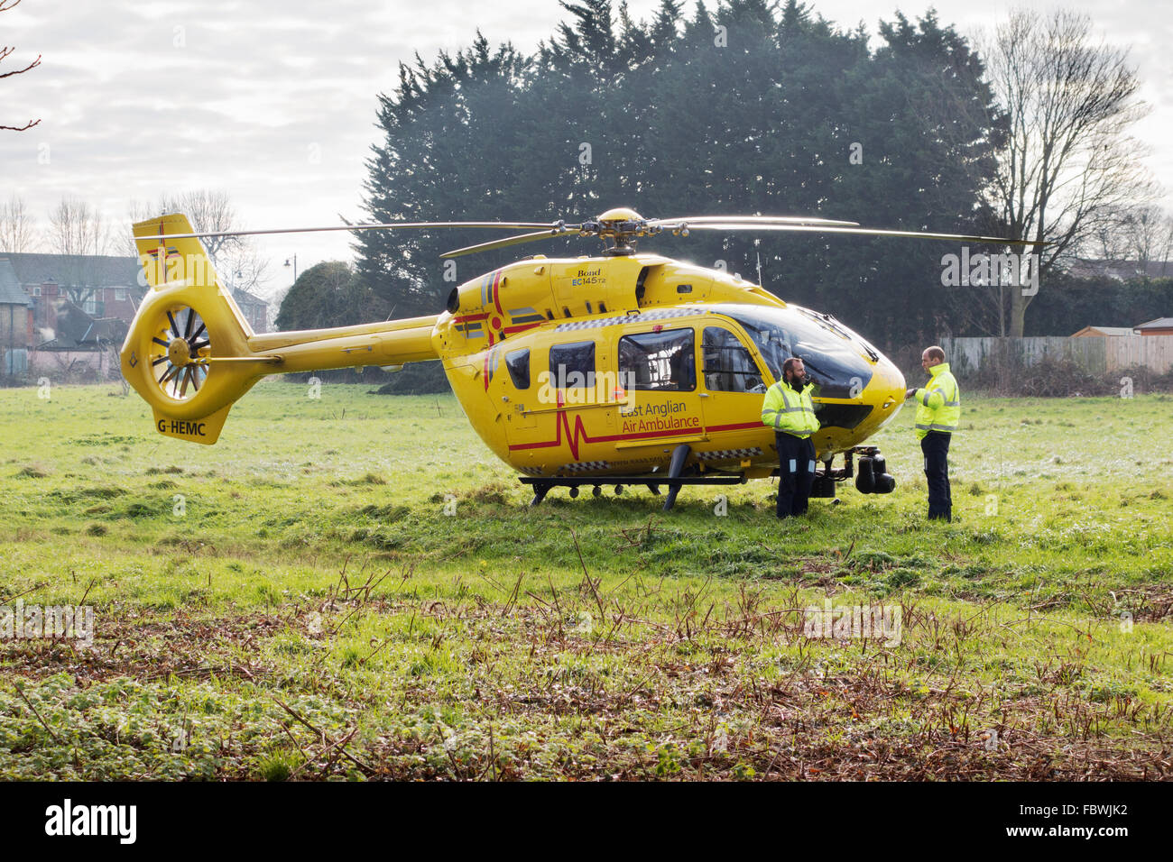 prince-william-standing-right-pilots-the-east-anglian-air-ambulance-FBWJK2.jpg