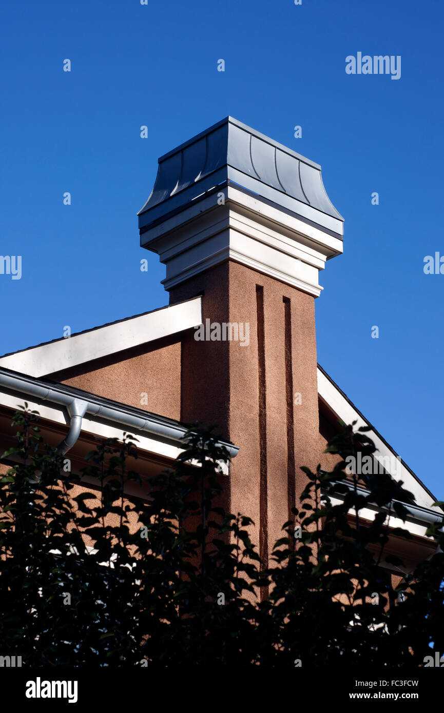 Decorative swoop chimney cap on the chimney of a new house, Vancouver, Canada Stock Photo