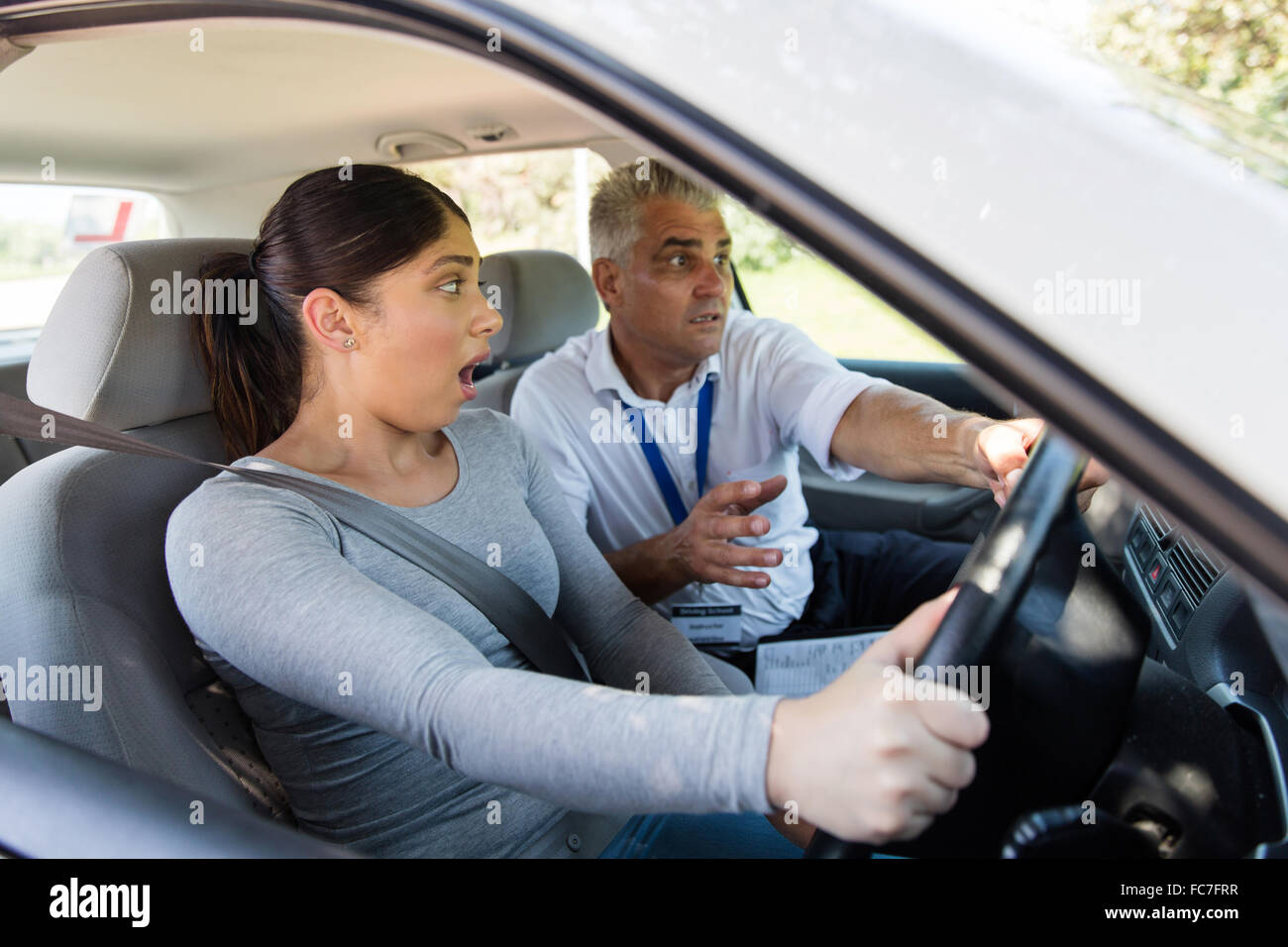 scared student driver making mistake during driving test Stock Photo