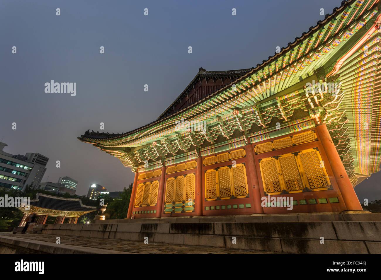 Junghwa-jeon (Throne Hall), Deoksugung Palace, traditional Korean building, illuminated at dusk, Seoul, South Korea, - Stock Image
