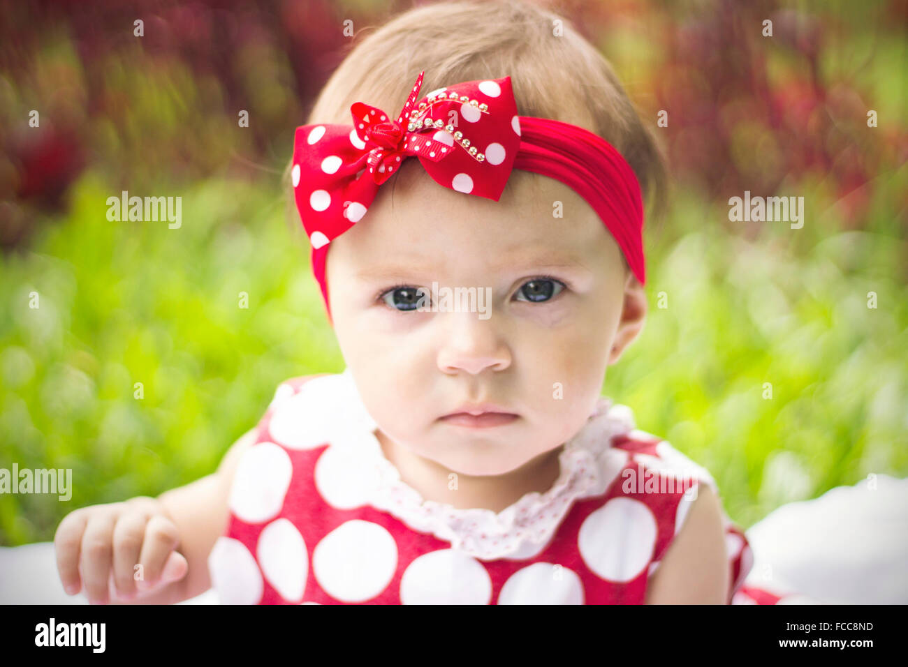 Close-Up Portrait Of A Pretty Baby Girl - Stock Image