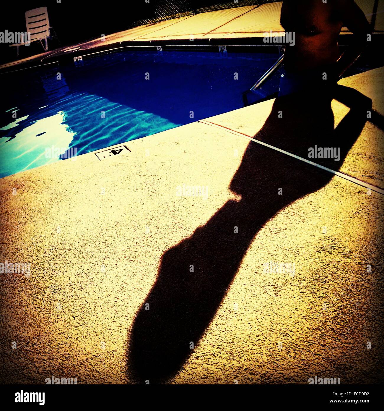 Shadow Of A Man At Poolside - Stock Image