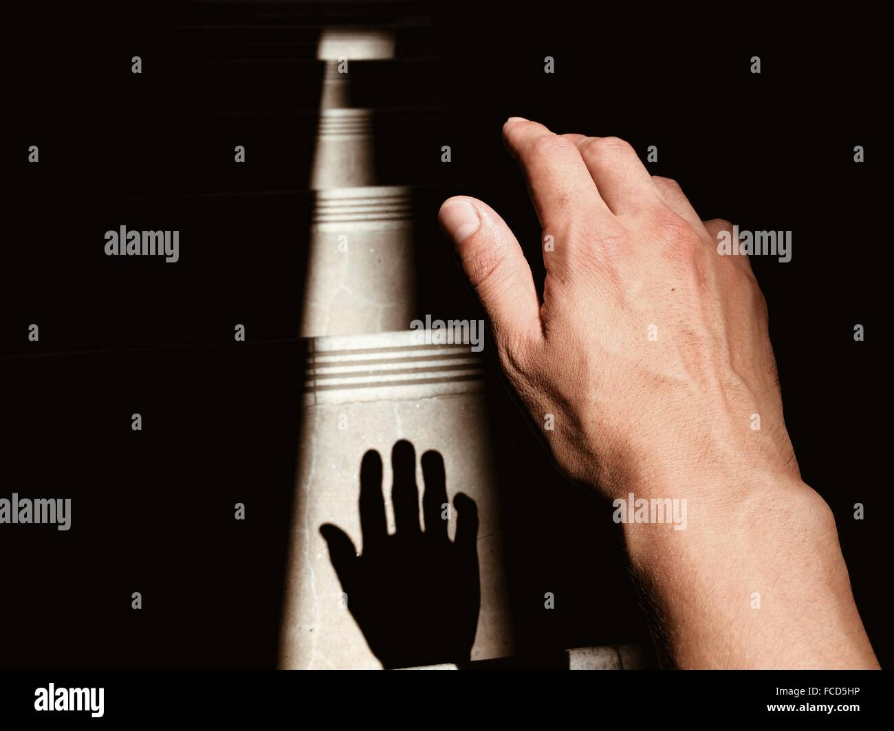 Close-Up Of Human Hand With Shadow - Stock Image